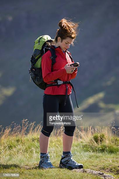 Caucasian female (20's) hiker with GPS unit