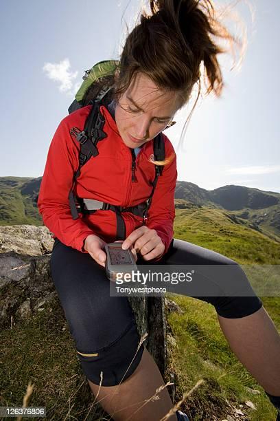 Caucasian female (20's) hiking in Lake District, Cumbria UK