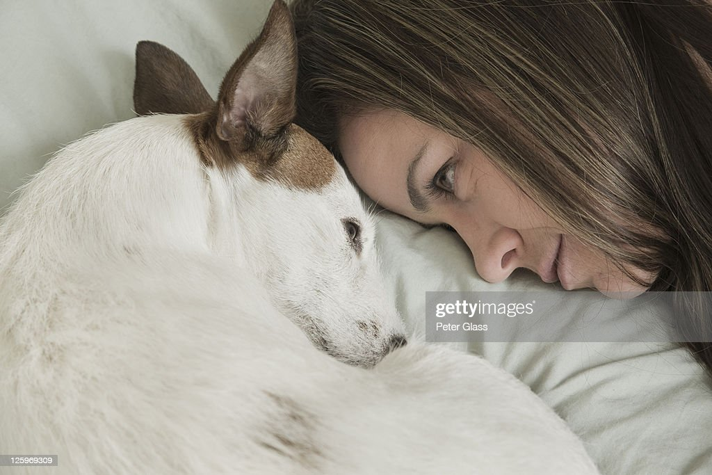 Caucasian female (31 years old) with her pet dog : Stock Photo