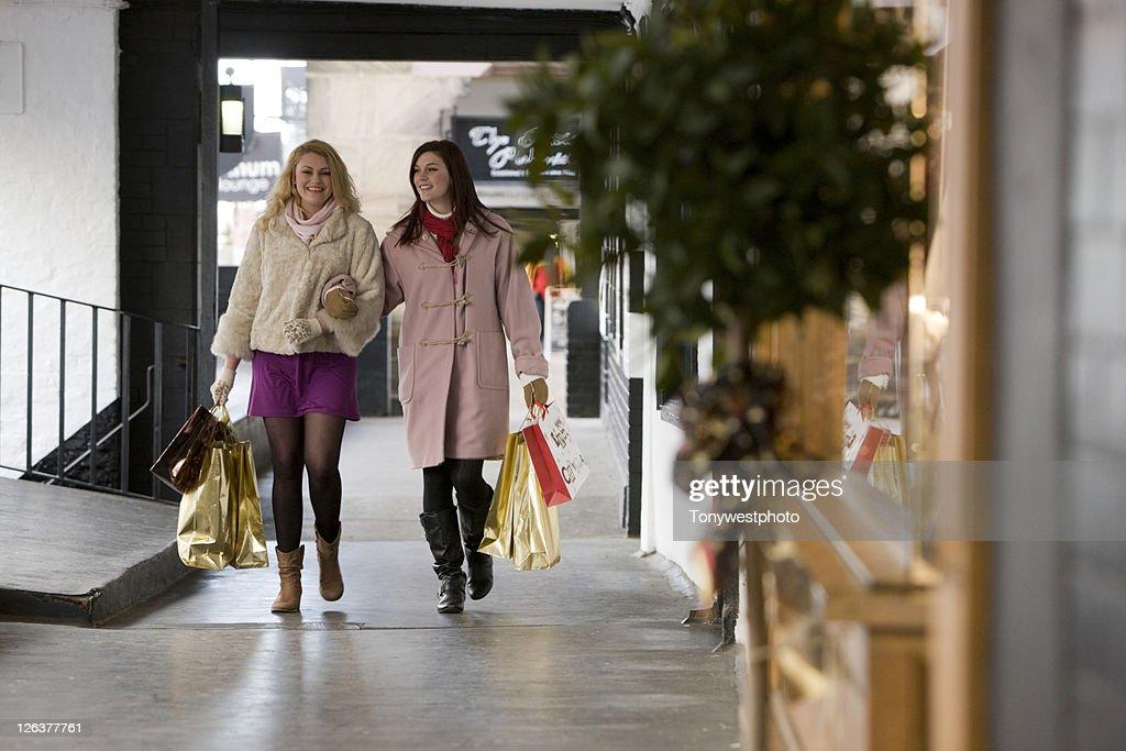 Caucasian females (20's) shopping in Chester, UK