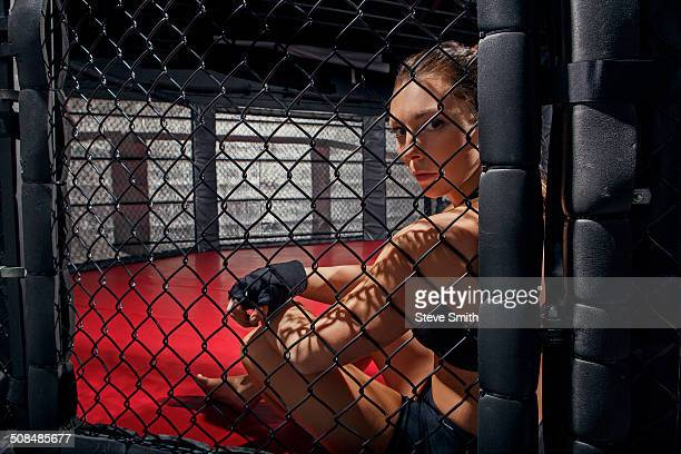 Caucasian fighter sitting in ring