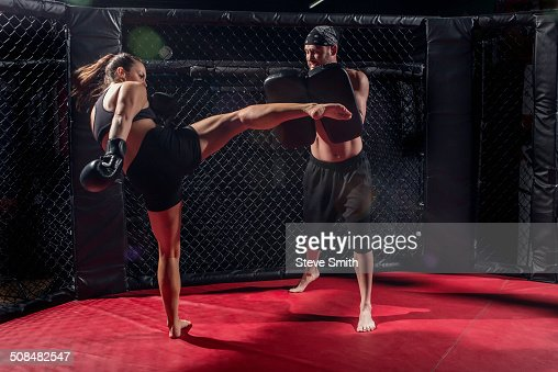 Caucasian fighters training in gym
