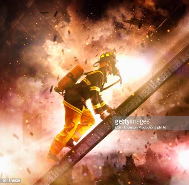 Caucasian firefighter climbing ladder