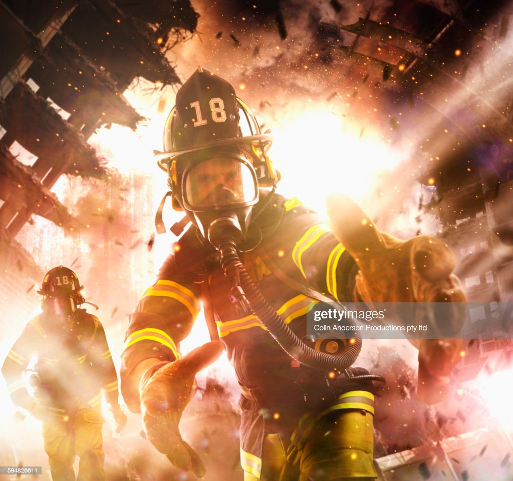 Caucasian Firefighter Reaching Into Burning Building Stock ...