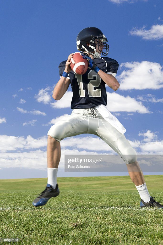 Caucasian football player poised on field