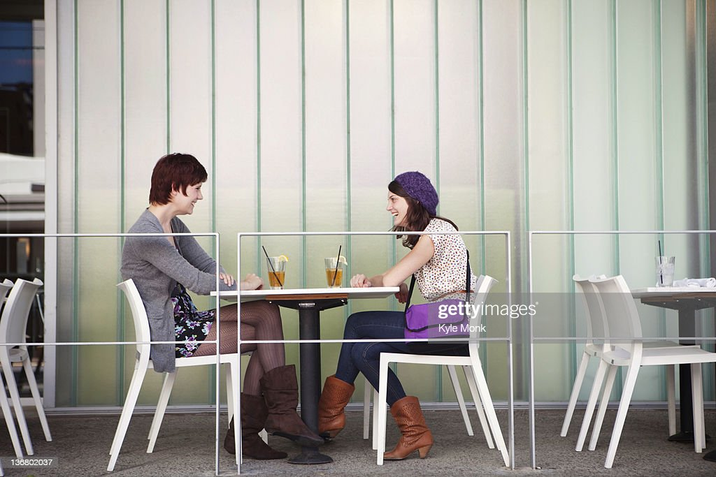 Caucasian friends having lunch in outdoor cafe : Photo