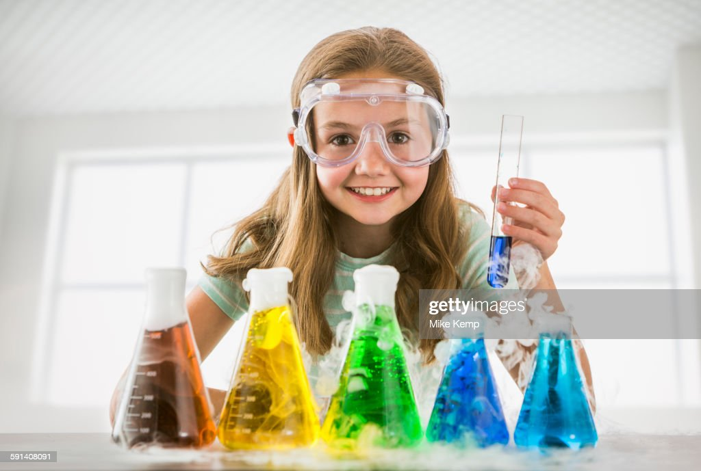 Caucasian girl doing science experiment