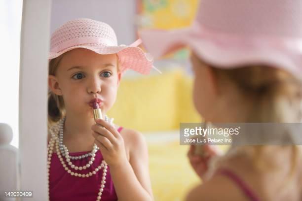 Caucasian girl dressing up