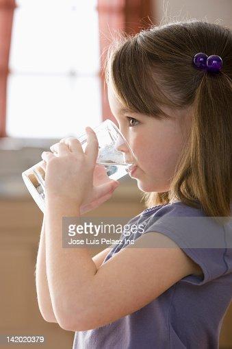 Caucasian girl drinking water : Stock Photo