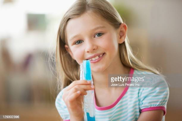 Caucasian girl eating flavored ice
