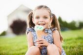 Caucasian girl eating ice cream outdoors