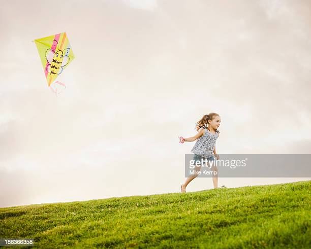 Caucasian girl flying kite