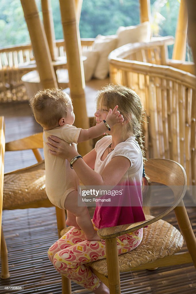 Caucasian girl holding baby boy : Stock Photo