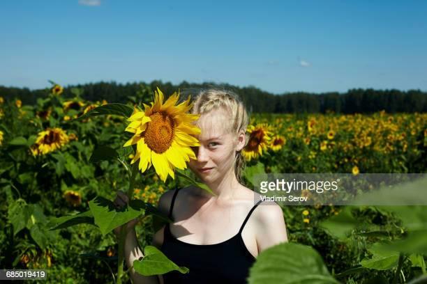 Caucasian girl holding sunflower