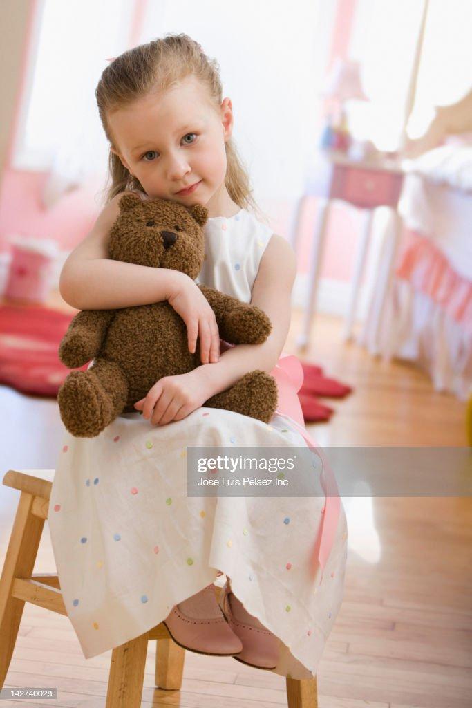 Caucasian girl holding teddy bear : Stock Photo