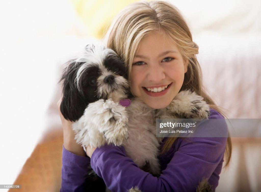 Caucasian girl hugging dog : Stock Photo