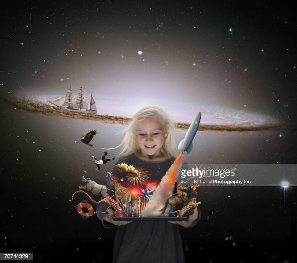 Caucasian girl imagining adventures in outer space