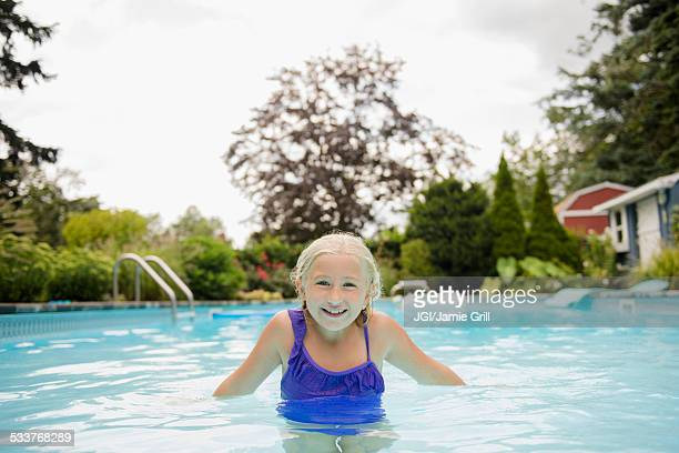 Caucasian girl in swimming pool