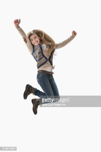 Caucasian girl jumping for joy