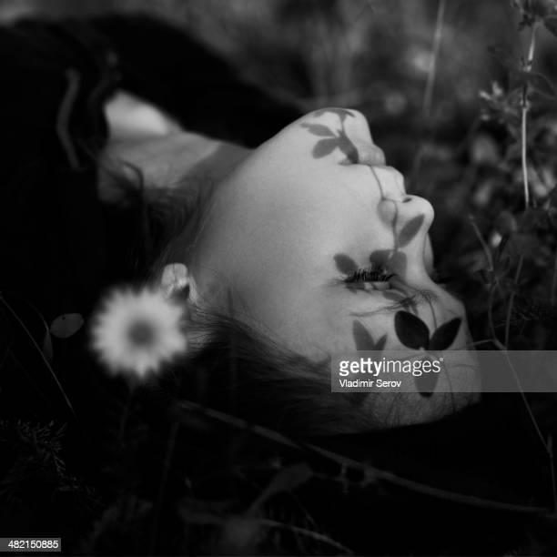 Caucasian girl laying in grass