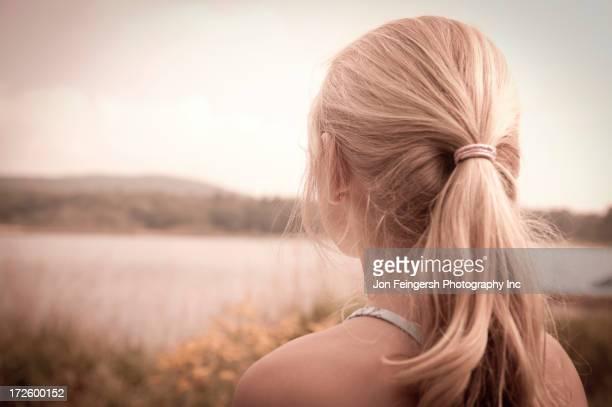 Caucasian girl overlooking rural landscape