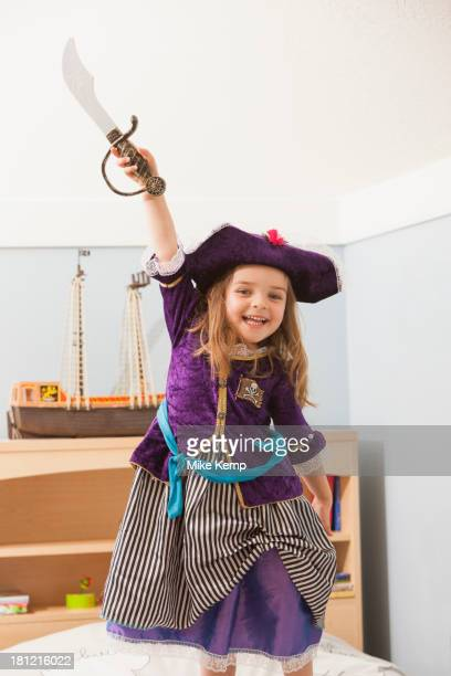 Caucasian girl playing dress up