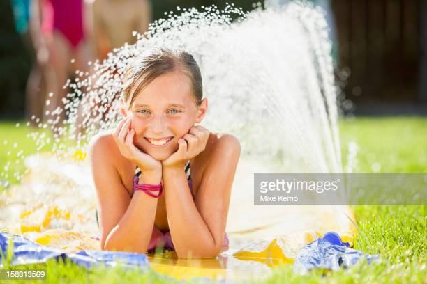 Caucasian girl playing in water