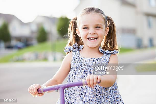 Caucasian girl playing outdoors