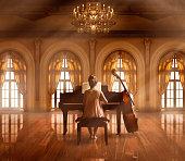 Caucasian girl playing piano in ballroom