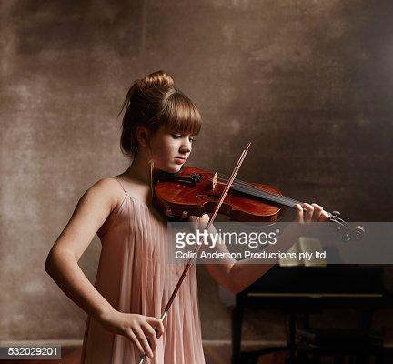 Caucasian girl playing violin