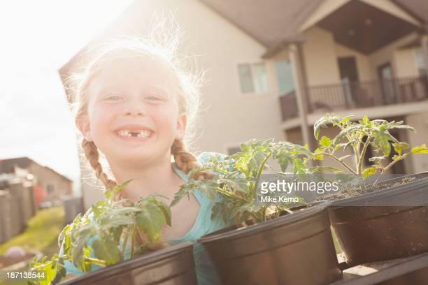 Caucasian girl showing gap tooth