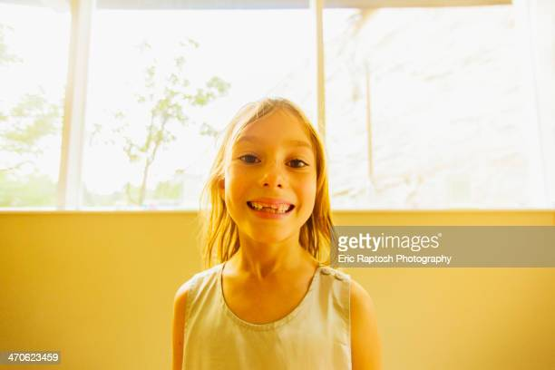 Caucasian girl showing gaps in teeth