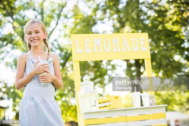 Caucasian girl smiling at lemonade stand