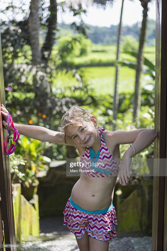 Caucasian girl smiling in tropical rainforest : Stock Photo