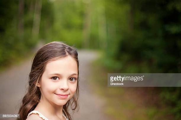 Caucasian girl smiling on dirt road