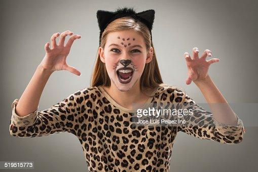 Caucasian girl snarling in leopard costume for Halloween