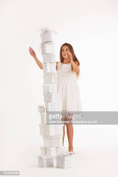 Caucasian girl stacking Christmas gifts