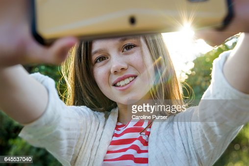 Caucasian girl (9-13) taking selfie : Bildbanksbilder