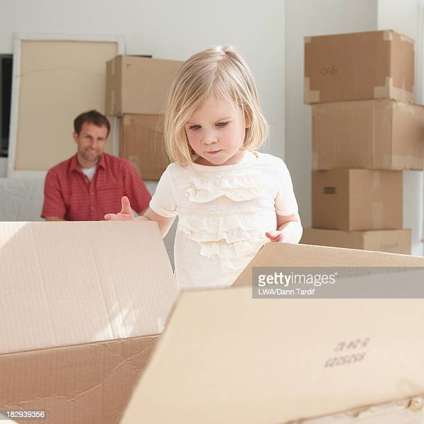 Caucasian girl unpacking in new home