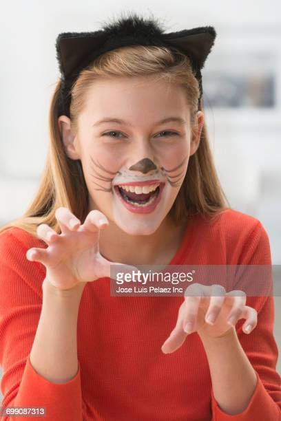Caucasian girl wearing cat costume
