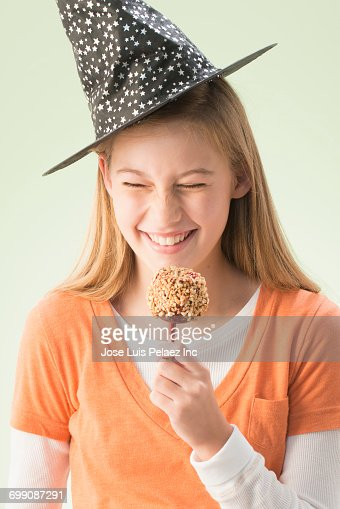 stock photo girl eating candy apple