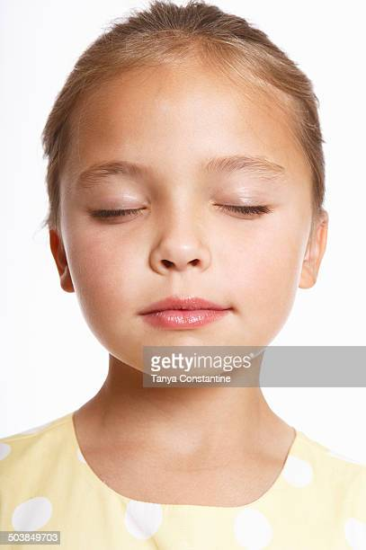 Caucasian girl with eyes closed