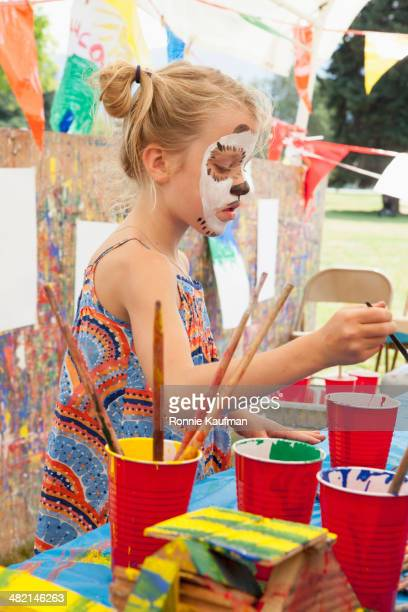 Caucasian girl with face paint at fair