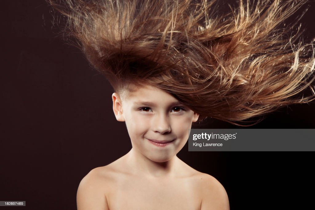 Caucasian girl with hair blowing in wind : Stock Photo