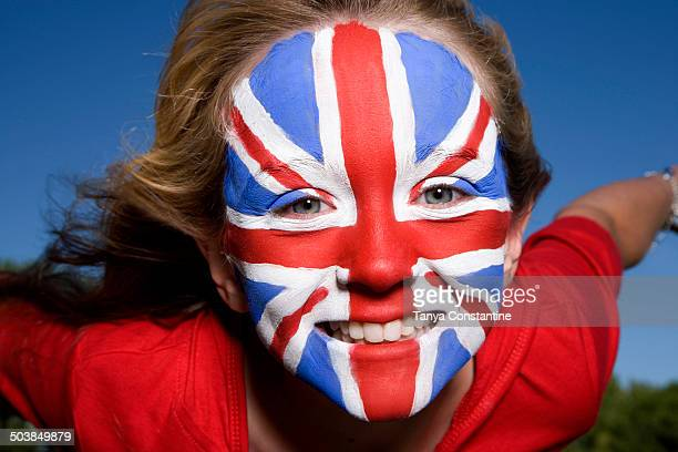 Caucasian girl with United Kingdom flag painted on face