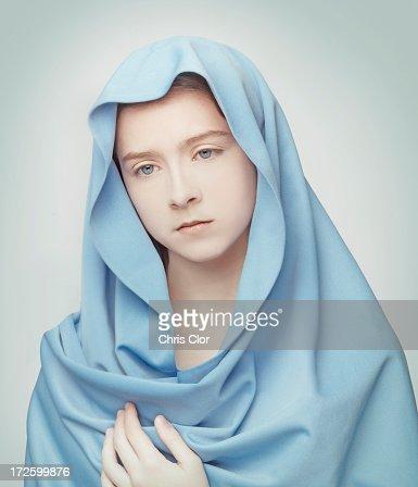 Caucasian girl wrapped in blanket