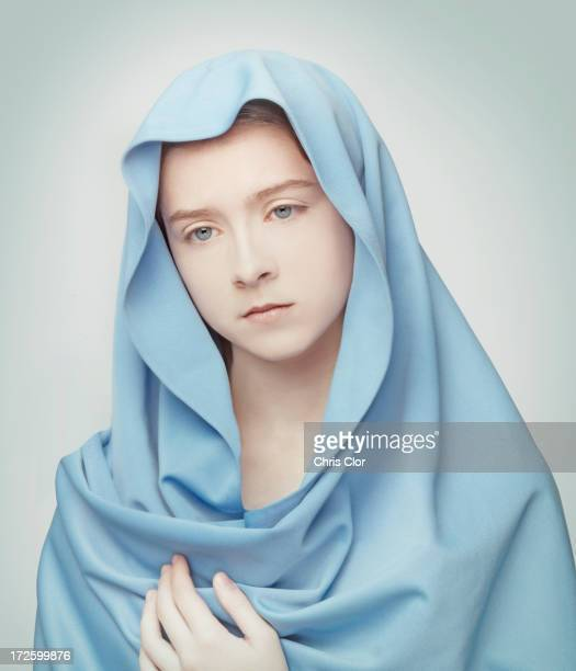 Caucasian girl wrapped in blanket