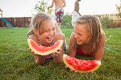 Caucasian girls eating watermelon
