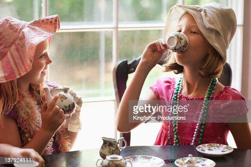 Caucasian girls having tea party