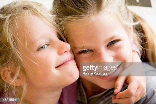 Caucasian girls hugging